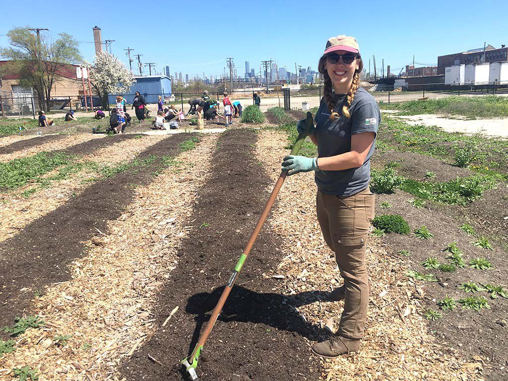 Jessica Surma, urban agriculture coordinator for Heartland Alliance, prepares the Chicago FarmWorks field for planting Sunday.   Mitch Dudek/Sun-Times