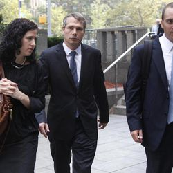 """Shepard Fairey, center, leaves Manhattan Federal court in New York with his attorneys, Dan Gitner, right, and Abigail Rosen, Friday, Sept. 7, 2012. Fairey, who created the """"HOPE"""" poster that came to symbolize Barack Obama's 2008 presidential campaign, was sentenced Friday to two years of probation and 300 hours of community service for destroying and fabricating documents in a civil lawsuit pertaining to The Associated Press photograph he relied upon to make the poster."""