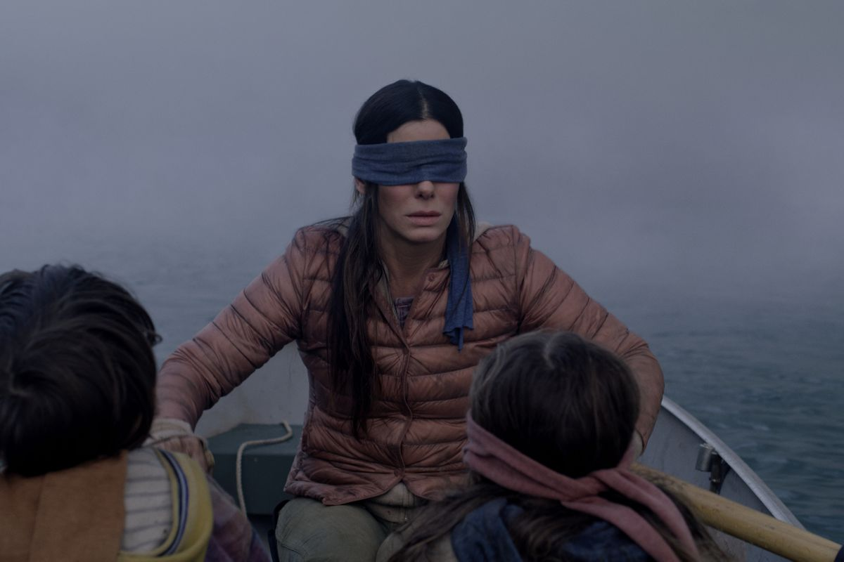 "Actress Sandra Bullock wearing a blindfold and rowing a boat in the Netflix original ""Bird Box."""