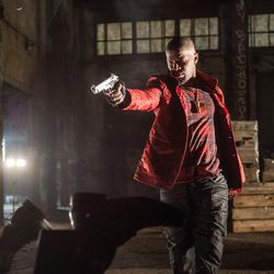 """Bats (Jamie Foxx) gets in a firefight within an abandoned rail yard as the crews gun deal goes bad in """"Baby Driver."""""""