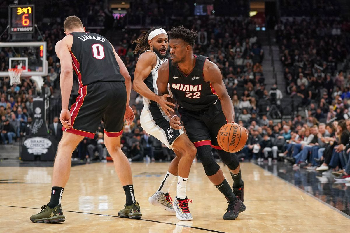 Miami Heat forward Jimmy Butler drives past San Antonio Spurs guard Patty Mills in the second half at the AT&T Center.