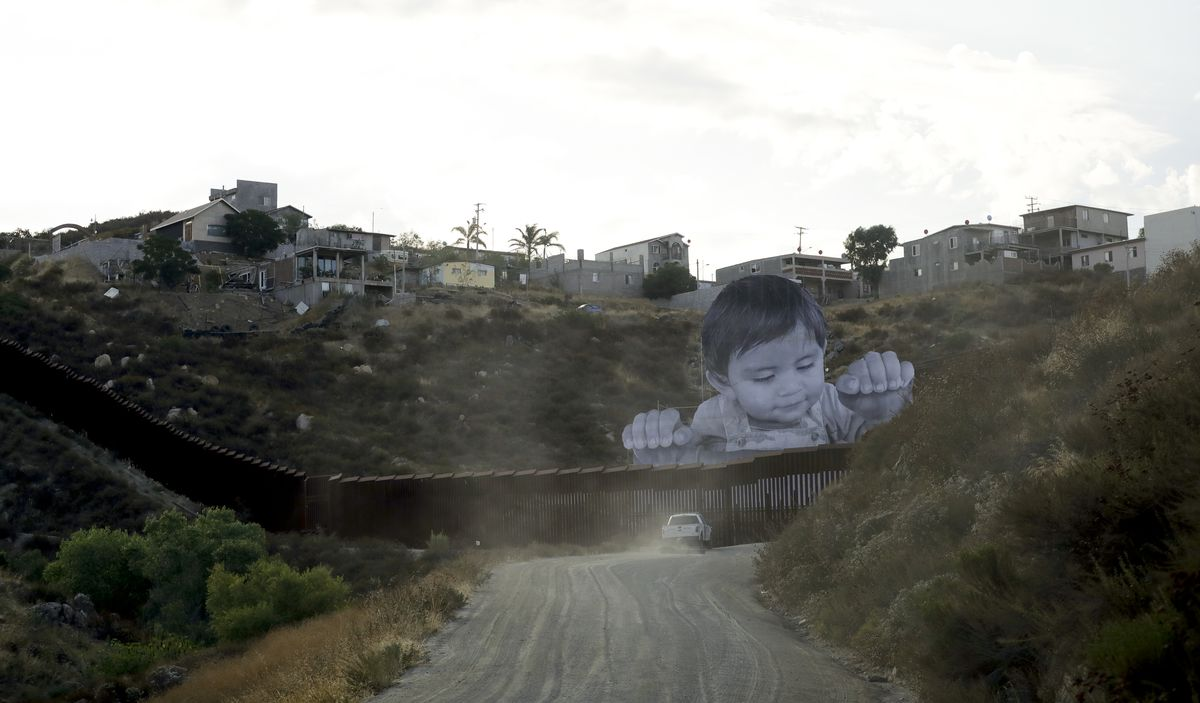 As JR was scouting for the perfect spot for his art installation, he noticed a house in Tecate near the border wall. After he talked to the owner about the possibility of locating it around there, it occurred to him that the 1-year-old at the home reminde