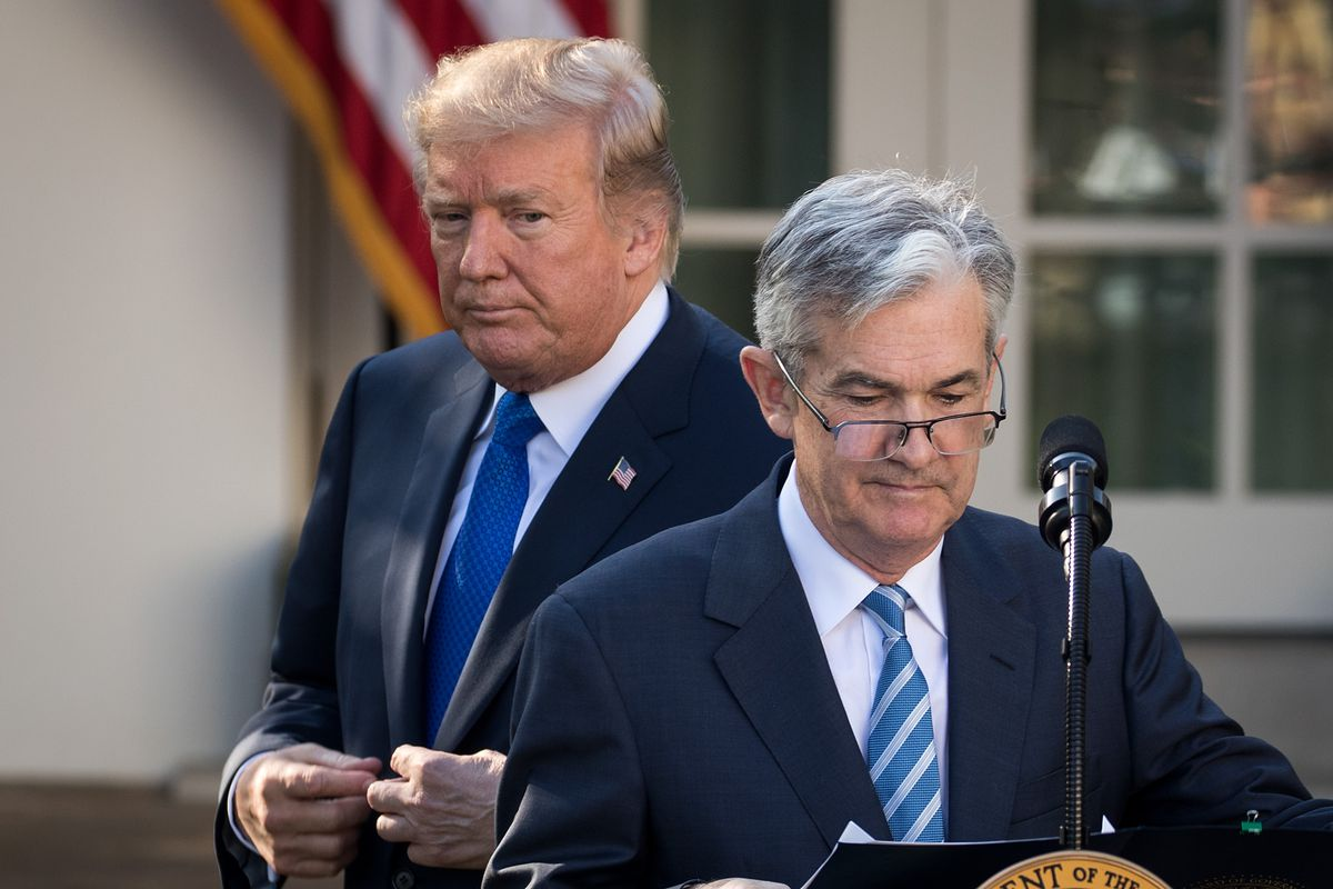 President Donald Trump looks on as Jerome Powell speaks at an event at the White House.