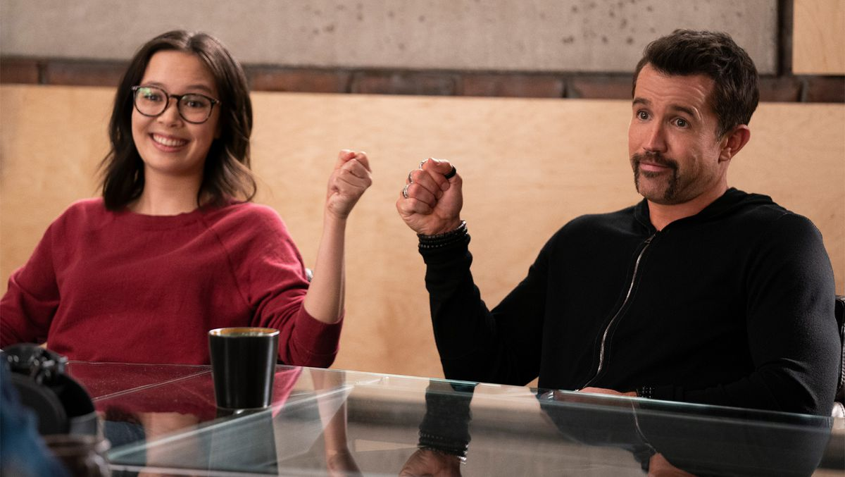 Charlotte Nicdao as Poppy Li and Rob McElhenney as Ian smile and bump fists in Mythic Quest