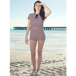 """This classic striped romper oozes Americana and is the perfect accompaniment to a bathing suit for a day spent near a body of water (the kiddie pool counts). <a href=""""http://store.americanapparel.net/product/?productId=rsa0365"""">Stripe T-Shirt Romper</a>,"""