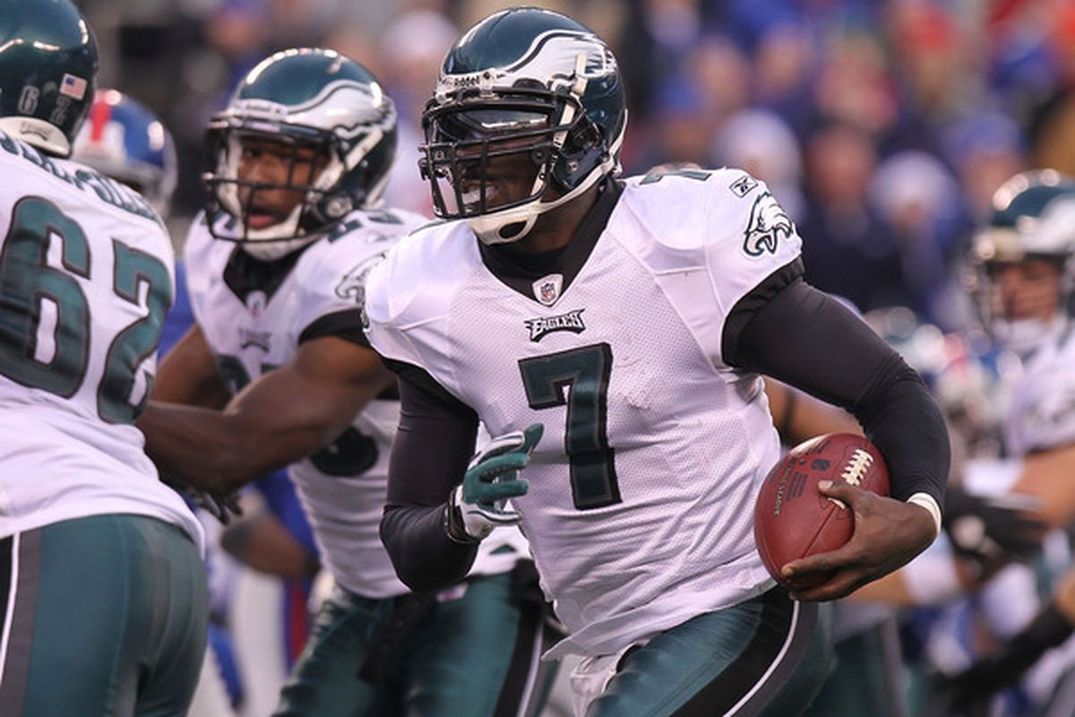 EAST RUTHERFORD NJ - DECEMBER 19:  Michael Vick #7 of the Philadelphia Eagles rushes for a touchdown against the New York Giants at New Meadowlands Stadium on December 19 2010 in East Rutherford New Jersey.  (Photo by Nick Laham/Getty Images)