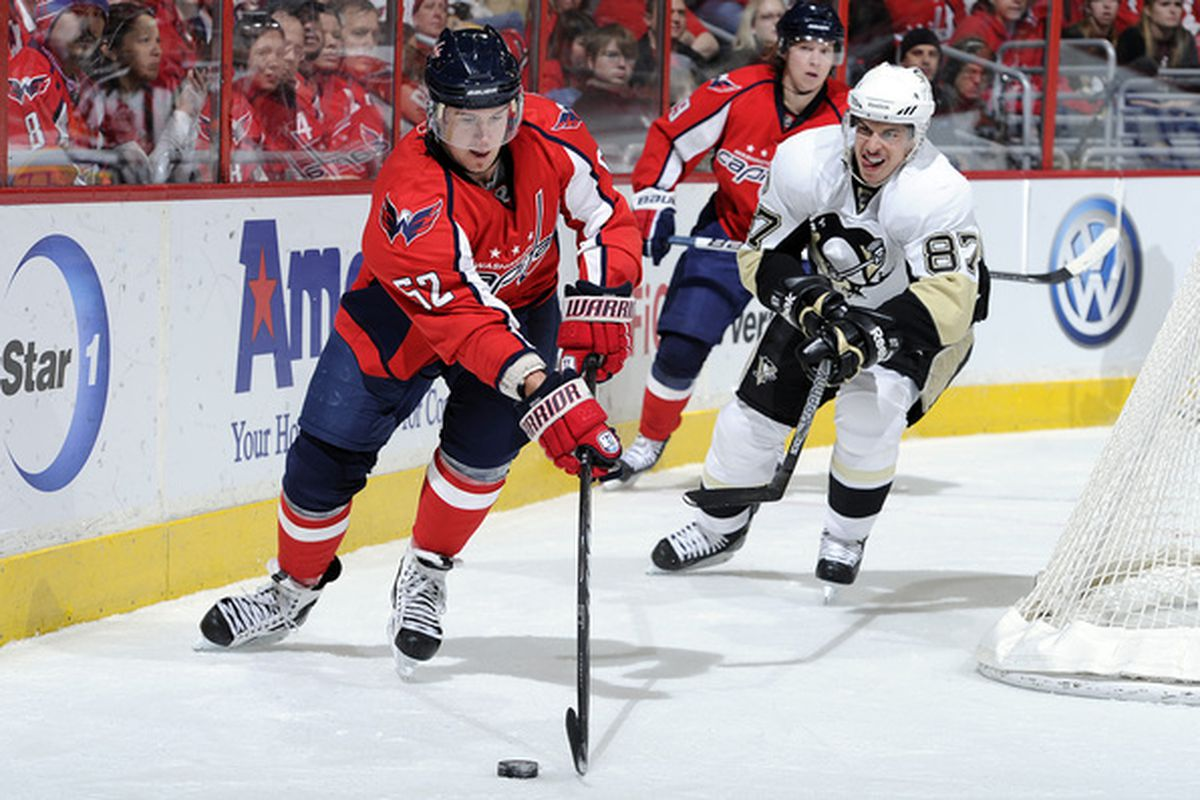 WASHINGTON DC - DECEMBER 23:  Mike Green #52 of the Washington Capitals battles for the puck against Sidney Crosby #87 of the Pittsburgh Penguins at the Verizon Center on December 23 2010 in Washington DC.  (Photo by Greg Fiume/Getty Images)
