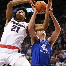 Gonzaga Bulldogs forward Rui Hachimura (21) and Brigham Young Cougars forward Luke Worthington (41) battle for the Ball as BYU and Gonzaga play in an NCAA basketball game in the Marriott Center in Provo on Saturday, Feb. 24, 2018.