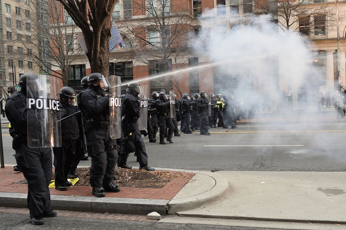 Protesters clash with police after the inauguration of US President Donald Trump on January 20, 2017 in Washington, DC.