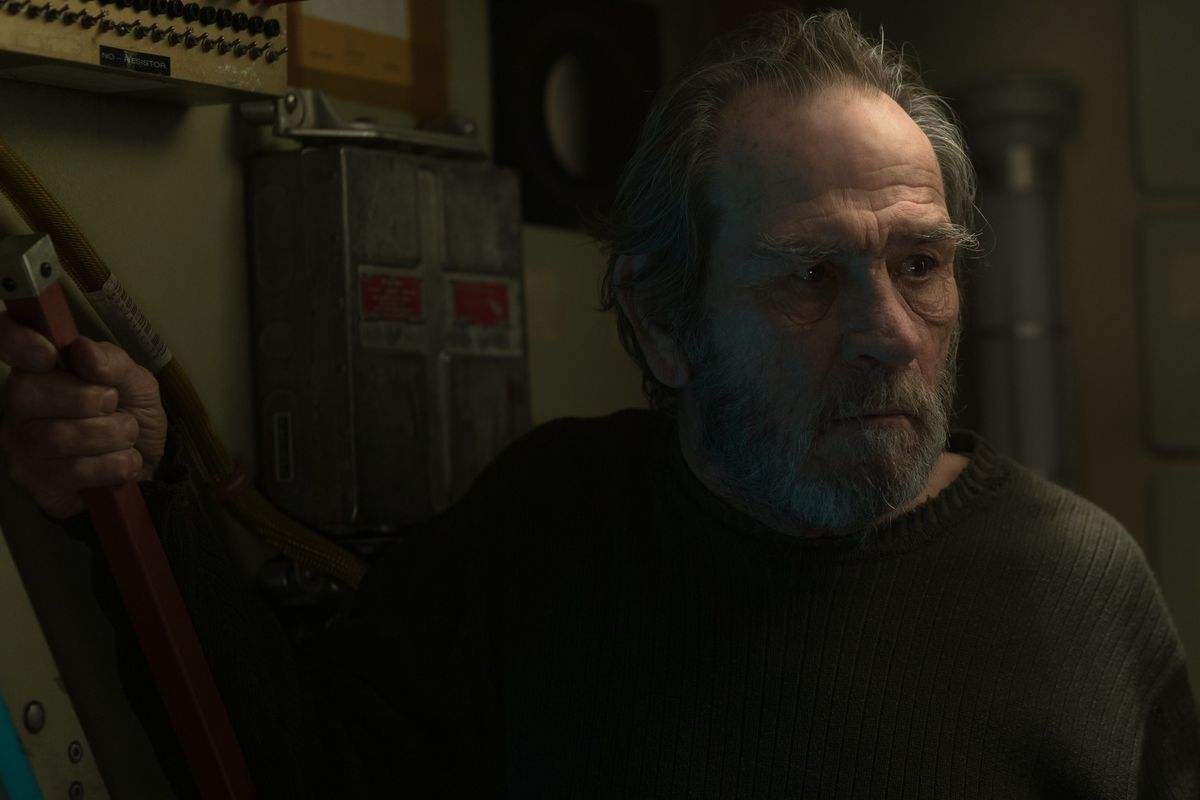 Tommy lee Jones as Roy's father, bearded, looking scared, and clinging to a handle of a space station interior