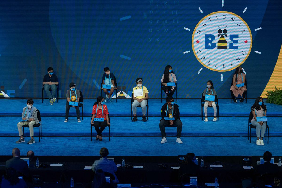 The 11 finalists of the Scripps National Spelling Bee sit on stage as the Finals begins, during a visit by US First Lady Jill Biden, in Orlando, Florida on July 8, 2021.