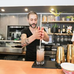 Bar Manager Jason Alonzo plays off tiki influences with the Smoked Swizzle.