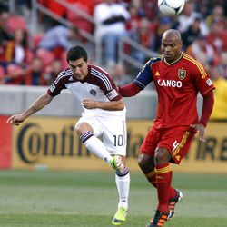 Jamison Olave of Real Salt Lake battles for control of the ball against Martin Rivero of the Colorado Rapids during their MLS match up at Rio Tinto Stadium in Sandy Saturday, April 7, 2012.