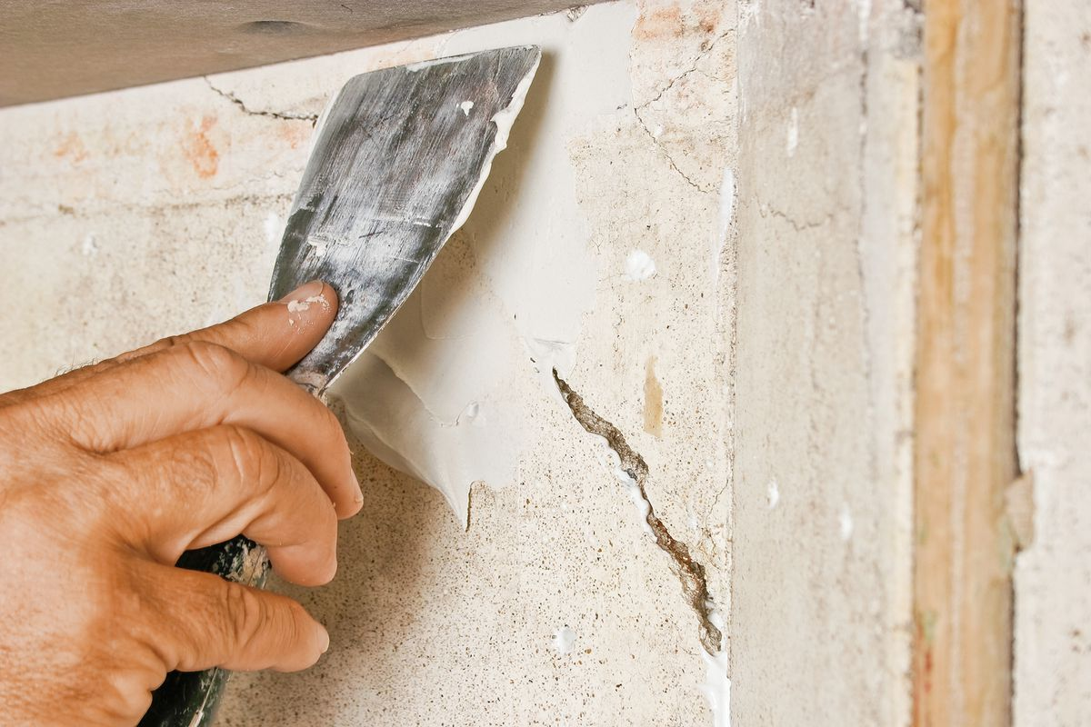 Man Fills Cracks With Setting-Type Joint Compound
