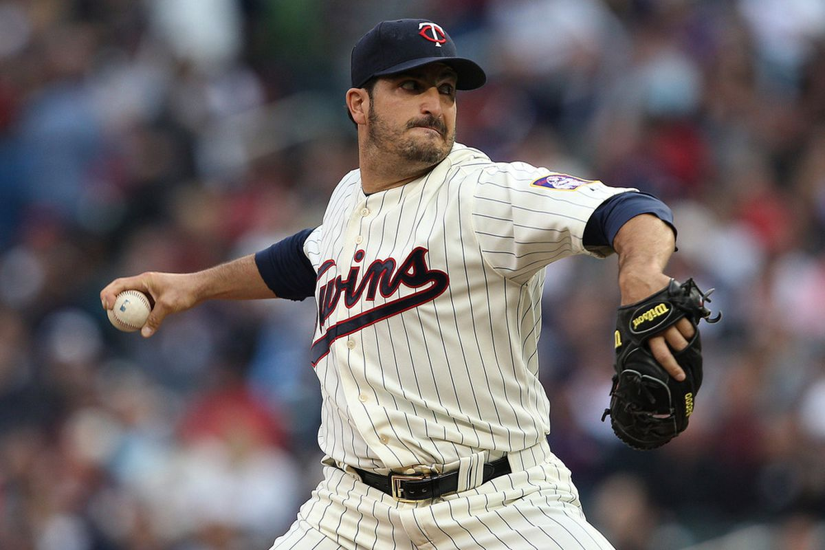 Apr 23, 2012; Minneapolis, MN, USA: Minnesota Twins starting pitcher Jason Marquis (21) delivers a pitch in the first inning against the Boston Red Sox at Target Field. Mandatory Credit: Jesse Johnson-US PRESSWIRE