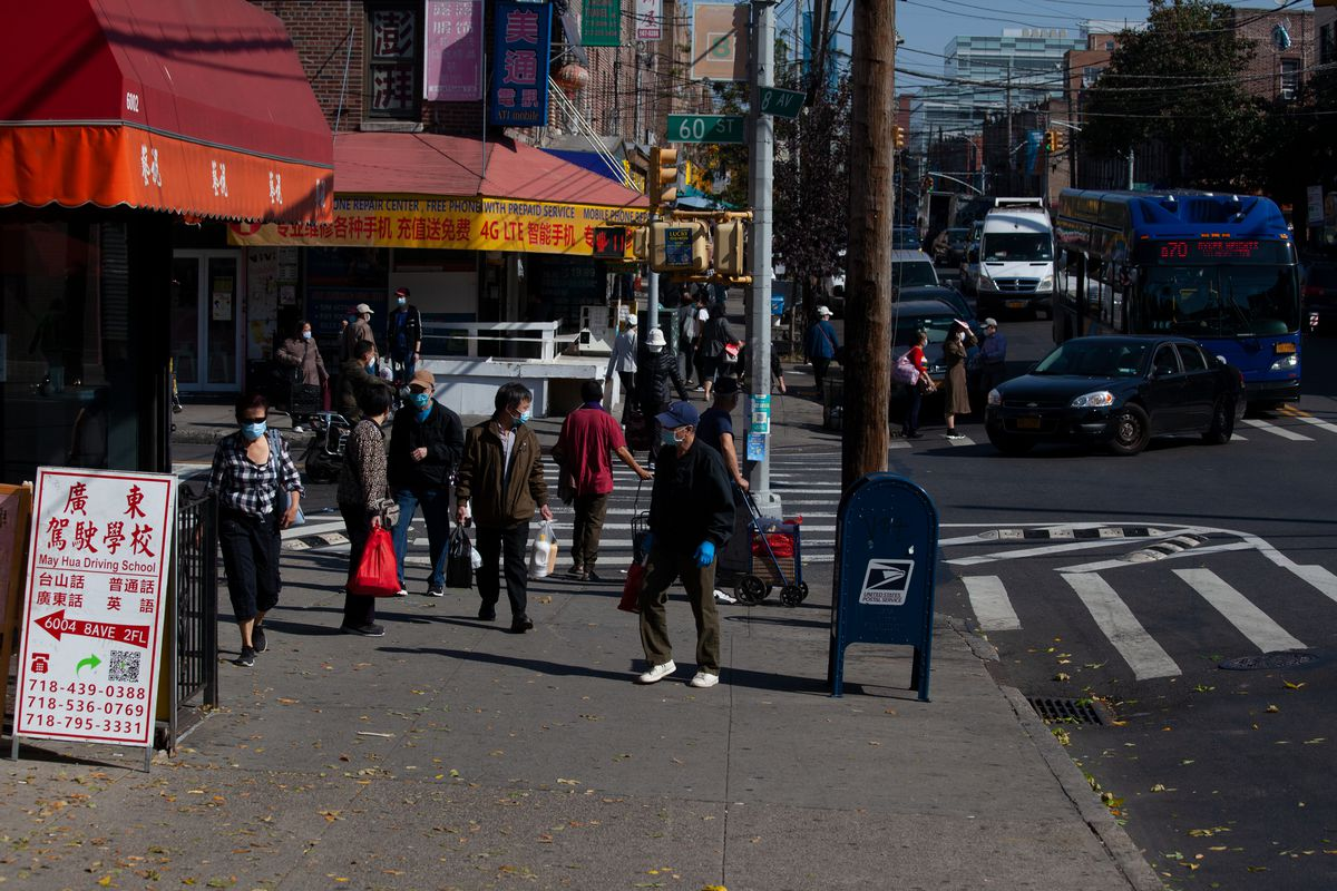 People shop along a busy strip of Eight Avenue in Sunset Park, Brooklyn, Oct. 7, 2020.