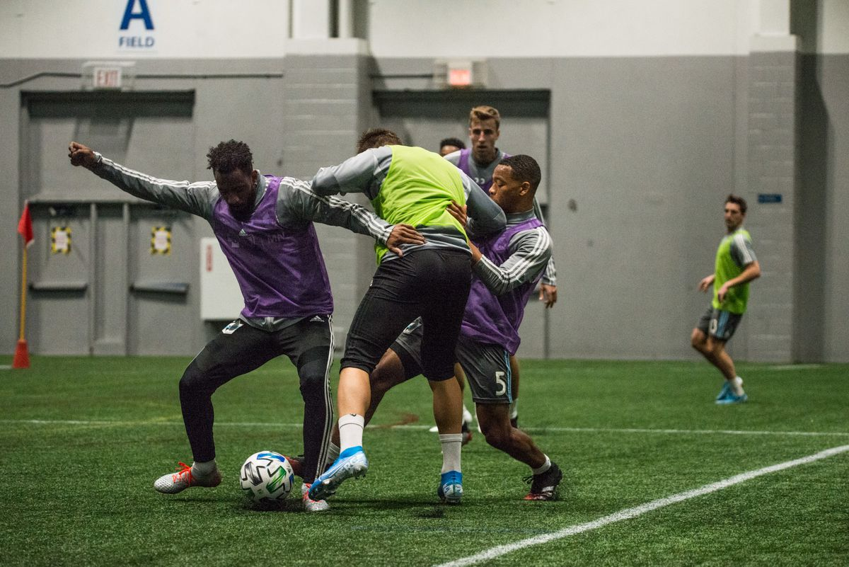 January 21, 2020 - Blaine, Minnesota, United States - Minnesota United players fight for a ball during a training session at National Sports Center. (Photo by Tim McLaughlin)