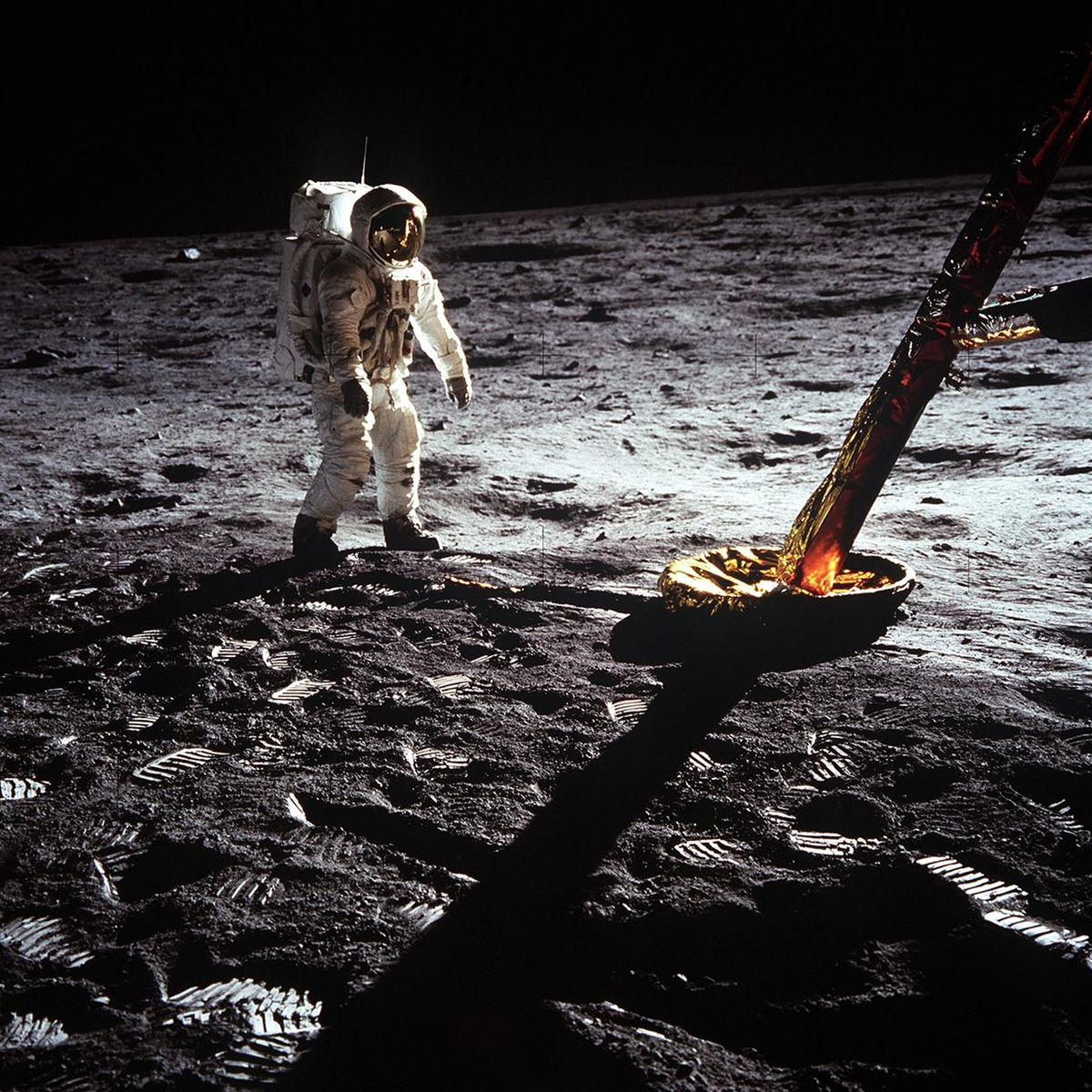 Astronaut on the moon next to Apollo 11 lunar lander