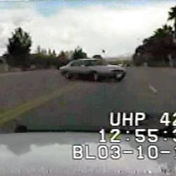 Dash camera video frame grab  from a UHP Trooper's patrol car just before the patrol car struck a passenger vehicle, killing both of it's occupants.