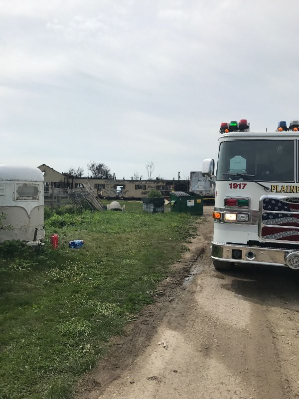 Firefighters remained on the scene Thursday morning after a fire destroyed a barn at the Del Real Stables in Plainfield, killing 18 horses. | GoFundMe