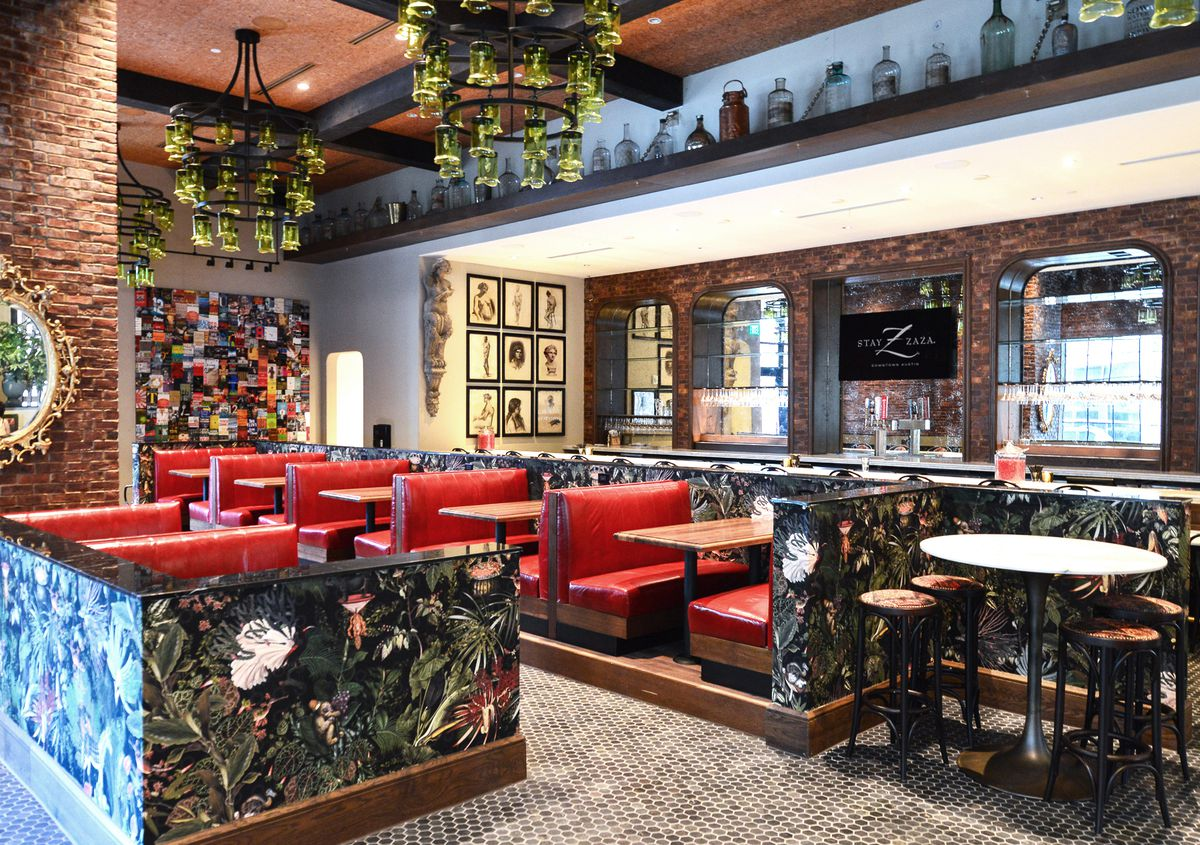 Green chandeliers, red booths, and floral wallpaper at Perfect Strangers restaurant at Hotel Zaza
