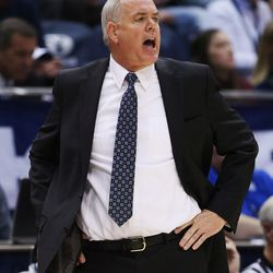 Brigham Young Cougars head coach Dave Rose shouts instruction in Provo on Thursday, Dec. 28, 2017. BYU won 69-45.