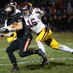 Loyola's Jake Gonzalez (16) chases down a Minooka ball carrier.  Allen Cunningham/For the Sun-Times.