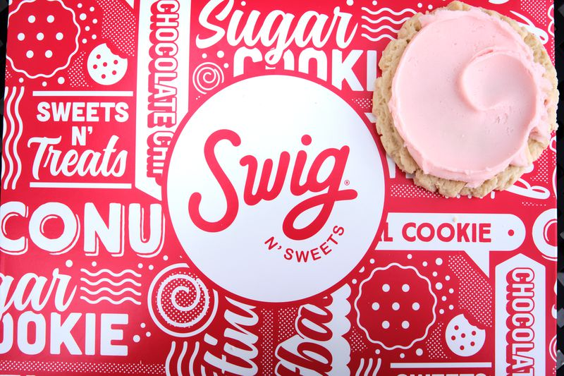 a Swig logo on a box with a cookie.