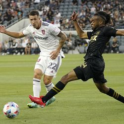 Los Angeles FC forward Raheem Edwards, right, reaches for the ball as Real Salt Lake defender Aaron Herrera defends during the first half of a Major League Soccer match Saturday, July 17, 2021, in Los Angeles.