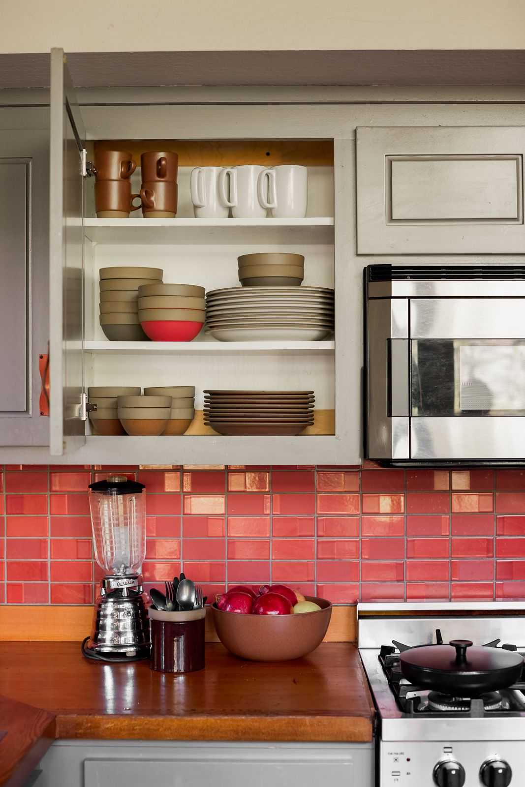 A kitchen counter with red tile.