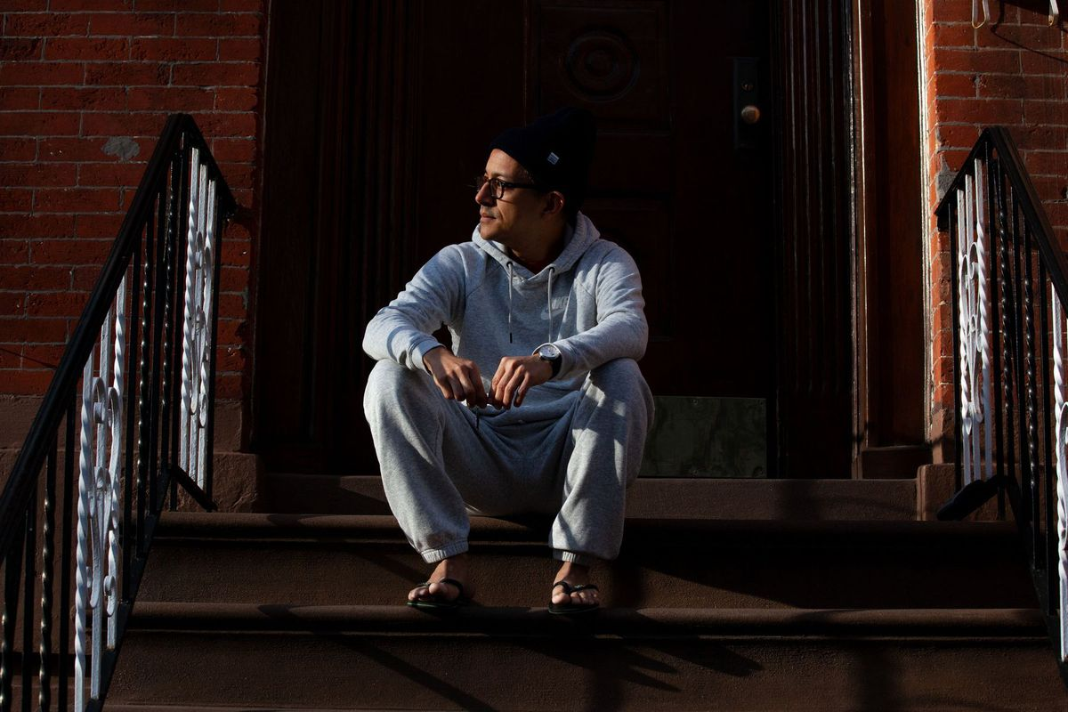 Cesar Cardenas gets some fresh air outside while quarantining in his Carroll Gardens apartment, March 22, 2020.