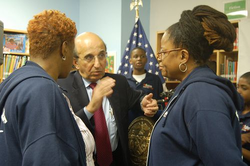 Chancellor Joel Klein speaks to two Explore Charter School parents. PTA president Stephanie Campbell is on the left.