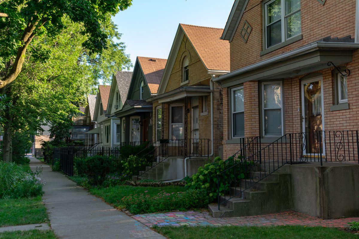 A row of brick homes in a neighborhood.