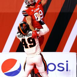 Utah Utes tight end Cole Fotheringham (89) makes a one-handed catch over Oregon State Beavers linebacker Andrzej Hughes-Murray (49) but is called out of bounds in the end zone as Utah and Oregon State play a college football game at Rice-Eccles Stadium in Salt Lake City on Saturday, Dec. 5, 2020.