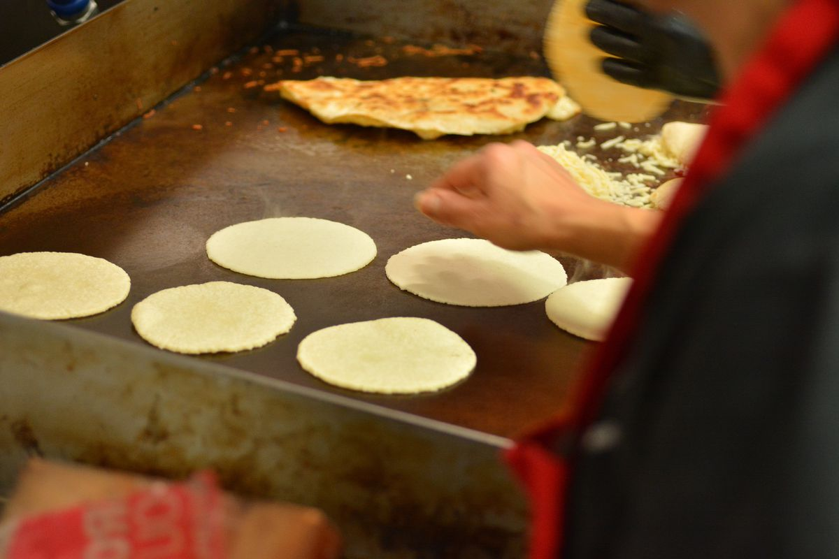 Handmade tortillas on the griddle