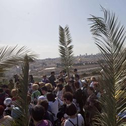Christian pilgrims participate in the traditional Palm Sunday procession on the Mount of Olives, overlooking Jerusalem's Old City, Sunday, April 1, 2012. Palm Sunday marks for Christians, Jesus Christ's entrance into Jerusalem, when his followers laid palm branches in his path, prior to his crucifixion.