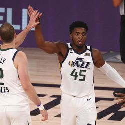 Utah Jazz guard Joe Ingles, left, and guard Donovan Mitchell, right, celebrates against the Denver Nuggets in Game 2 of an NBA basketball first-round playoff series, Wednesday, Aug. 19, 2020, in Lake Buena Vista, Fla.