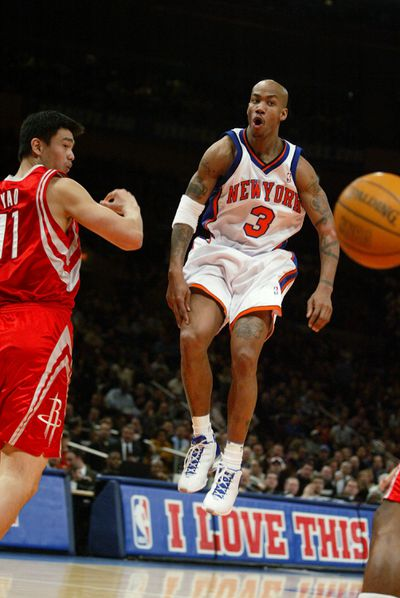 New York Knicks' Stephon Marbury passes the ball in front of