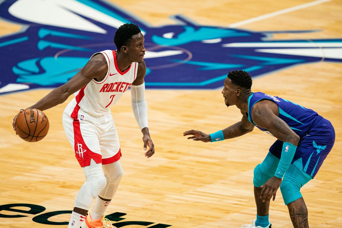 Victor Oladipo of the Houston Rockets looks to pass the ball while guarded by Terry Rozier of the Charlotte Hornets during the first quarter at Spectrum Center on February 08, 2021 in Charlotte, North Carolina.