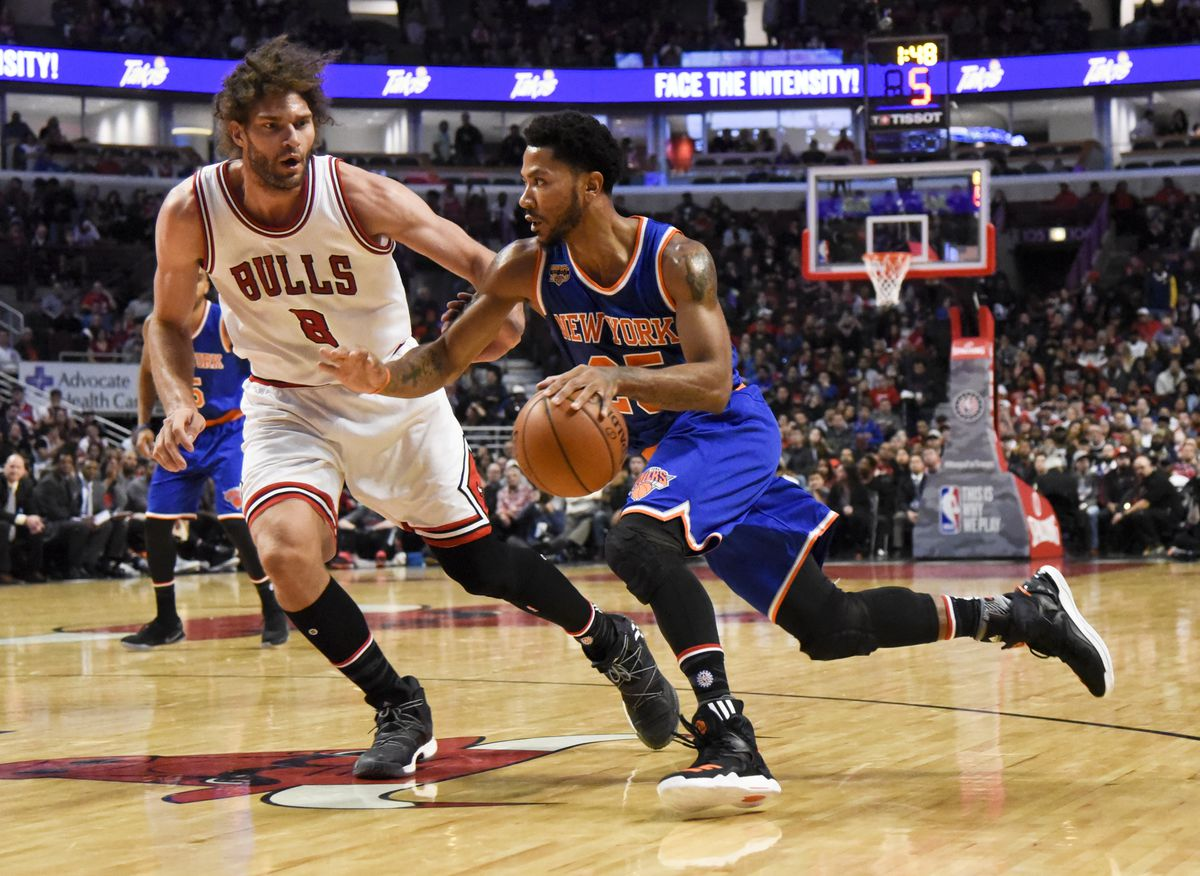 1485ab53733f Mary Altaffer Associated Press Derrick Rose drives against Robin Lopez  during the first quarter of an NBA basketball game on