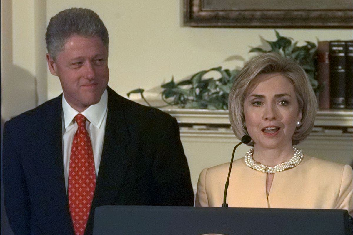 Hillary stands by Bill as he denies inappropriate relations with White House intern Monica Lewinsky.