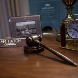 A gavel and name placard sit on an end table in the office of Sen. Orrin Hatch, R-Utah, in the Hart Senate Office Building in Washington, D.C., on Thursday, Jan. 19, 2017.