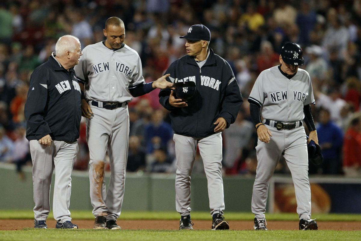 Sep 12, 2012; Boston, MA, USA; New York Yankees shortstop Derek Jeter (2) is helped after an injury as they take on the Boston Red Sox during the eighth inning at Fenway Park. Mandatory Credit: David Butler II-US PRESSWIRE