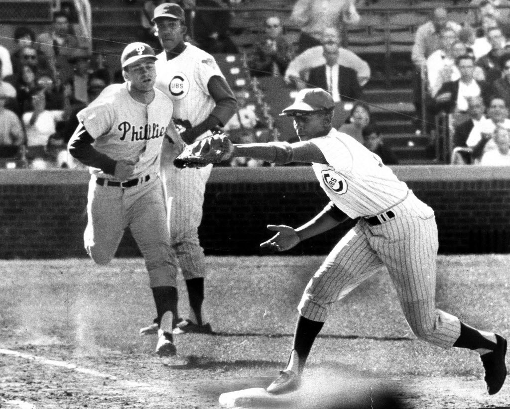 September 6, 1966, Phillies's Doug Clemens is out at first in eighth inning on grounder to Glenn Beckert. Ernie Banks takes throw as pitcher Ferguson Jenkins backs up play.   Sun-Times library
