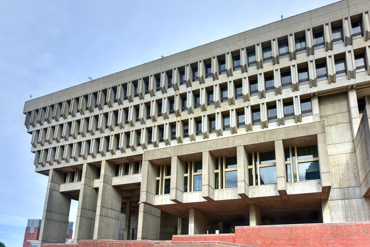 The exterior of Boston City Hall. The facade is concrete.