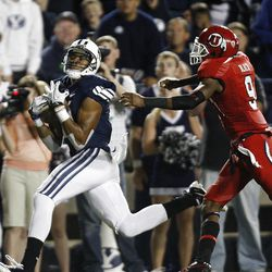 Brigham Young Cougars wide receiver Ross Apo (11) gathers in a pass for a touchdown during play as BYU and Utah play Saturday, Sept. 17, 2011