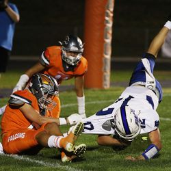 Skyridge's Collin Sheffield (5) sacks Fremont QB Cannon Koford and recovers a fumble for a touchdown in Lehi on Thursday, Aug. 12, 2021.