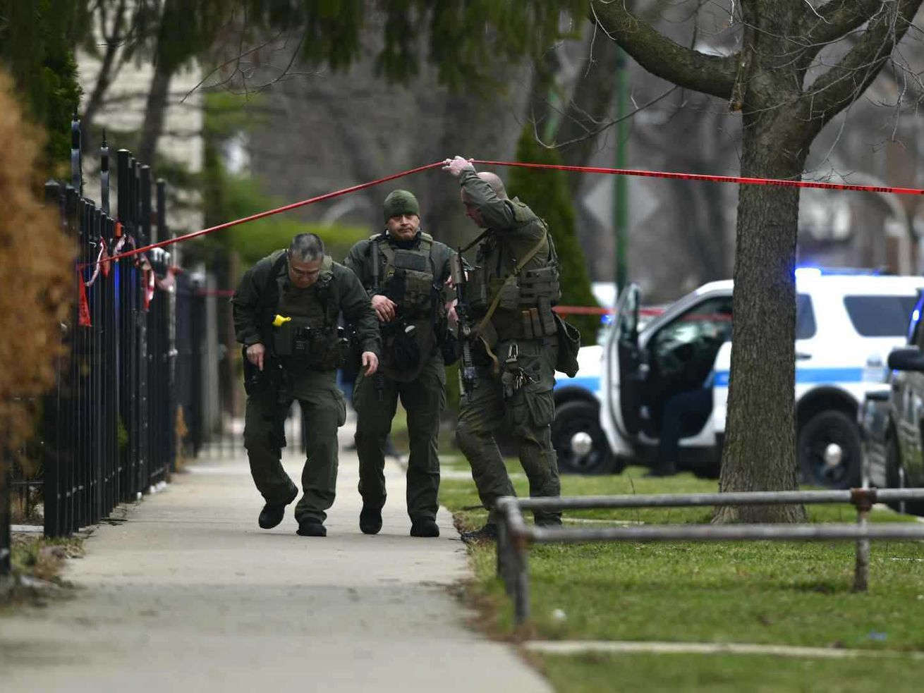 Police investigate after a police officer was shot March 25, 2021, in the Brighton Park neighborhood.