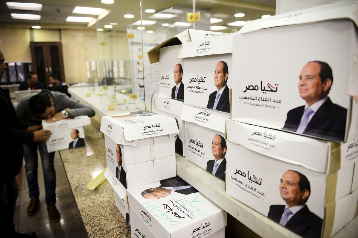 Members of Egyptian President Abdel Fattah al-Sisi's presidential campaign staff stand next to boxes containing signatures in his support, needed to register for the elections, at the National Election Authority, in Cairo, Egypt, on January 24, 2018.