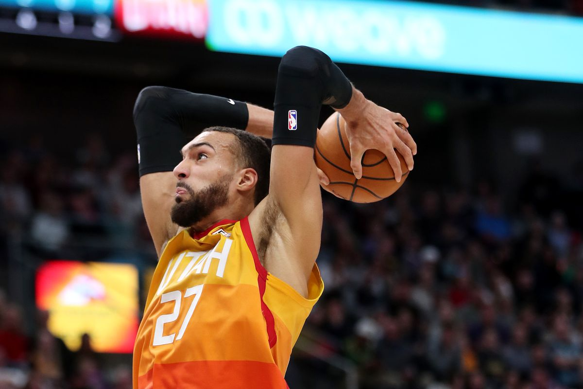 Utah Jazz center Rudy Gobert (27) goes up for a dunk as the Utah Jazz and the Charlotte Hornets play an NBA basketball game at Vivint Arena in Salt Lake City on Friday, Jan. 10, 2020.